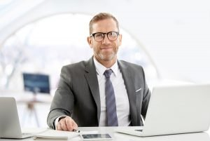financial advisor sitting at desk